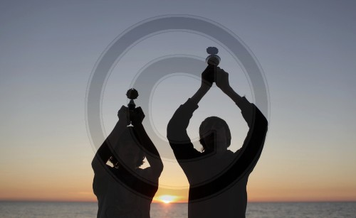 Winners - Children with cups on the beach of the Baltic sea. Rerik, Germany. 04.06.2011. MODEL RELEASE available.