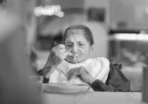 Old woman eating in the nursing home of Wipperfuerth. Wermelskirchen, Germany. 14.06.2011. MODEL RELEASE available.
