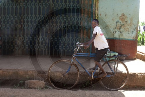 Boy with a bicycle. Nyeri, Kenya. 17.01.2012