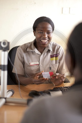 Issuing of microcredits at the bank FINCA in Kampala. Uganda, Africa.
